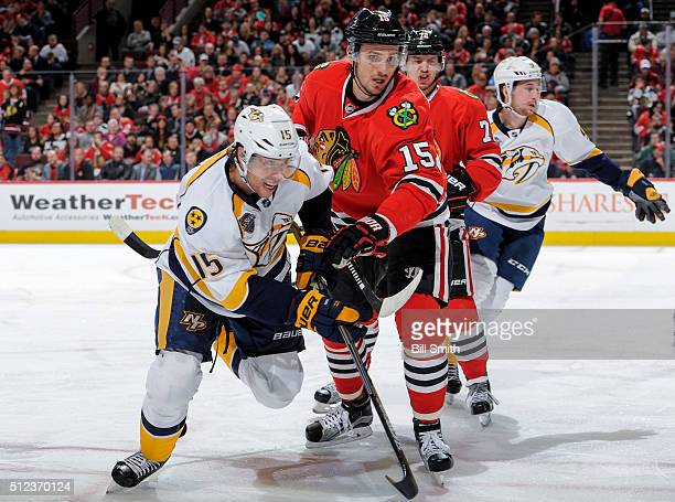 Craig Smith of the Nashville Predators and Artem Anisimov of the Chicago Blackhawks get physical during the NHL game at the United Center on February...