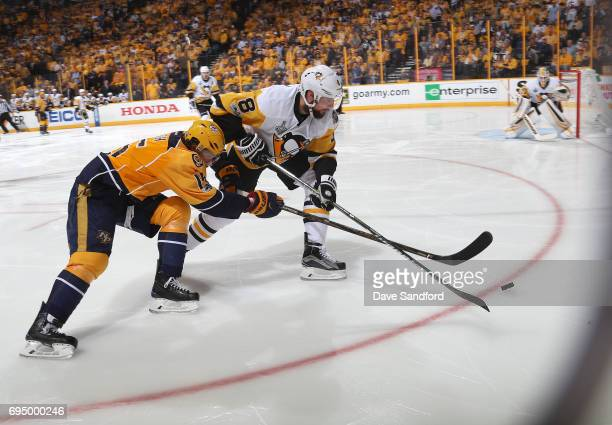 Craig Smith of the Nashville Predators and Brian Dumoulin of the Pittsburgh Penguins vie for the puck in the third period of Game Six of the 2017 NHL...
