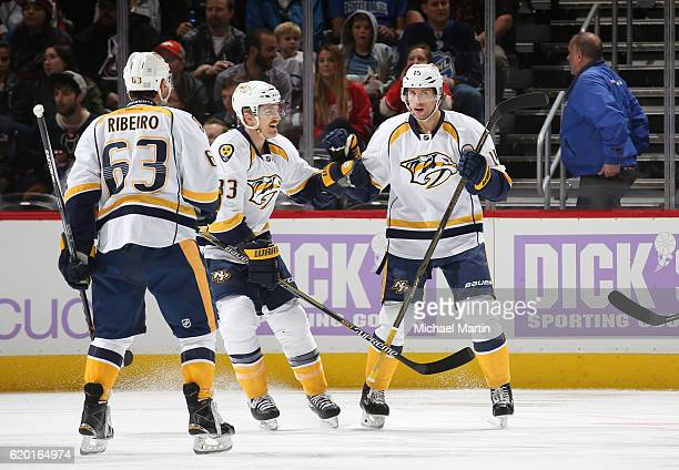 Craig Smith of the Nashville Predators celebrates a goal against the Colorado Avalanche with teammates Colin Wilson and Mike Ribeiro at the Pepsi...