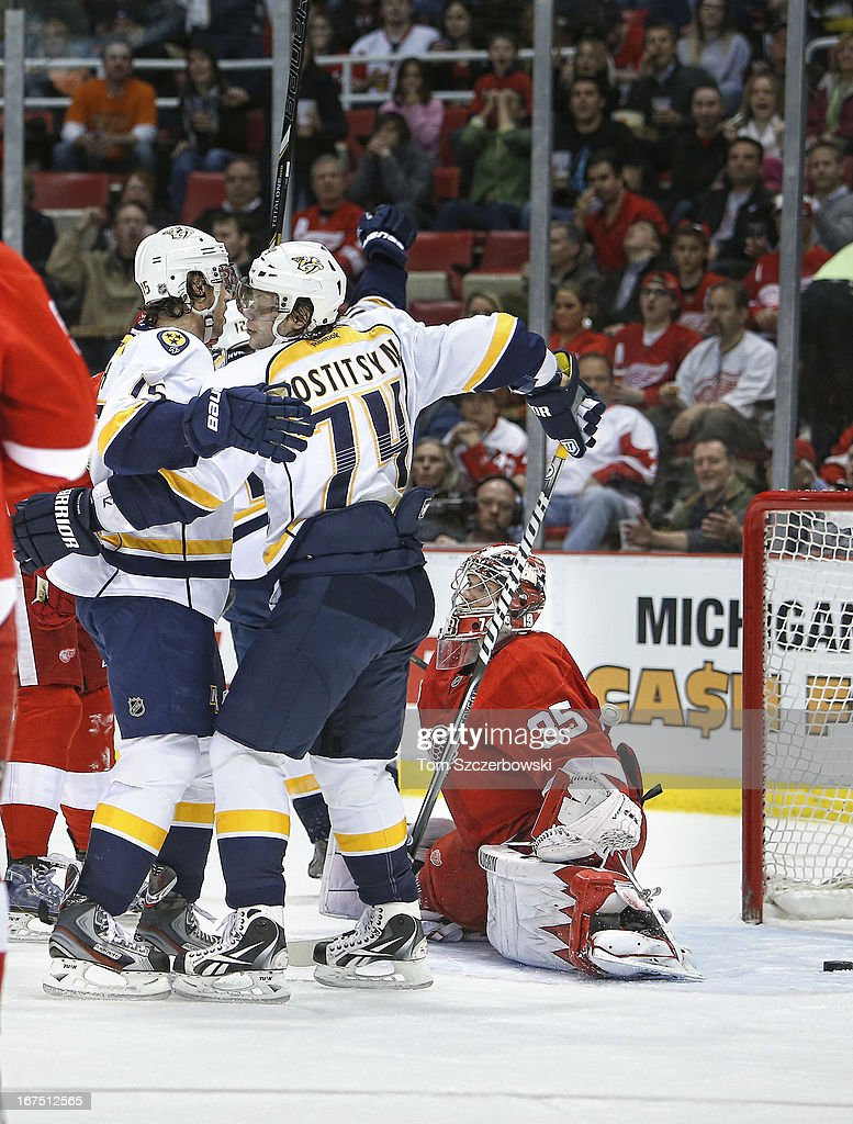 Craig Smith #15 of the Nashville Predators celebrates his goal with <a gi-track='captionPersonalityLinkClicked' href=/galleries/search?phrase=Sergei+Kostitsyn&family=editorial&specificpeople=599906 ng-click='$event.stopPropagation()'>Sergei Kostitsyn</a> #74 during an NHL game as <a gi-track='captionPersonalityLinkClicked' href=/galleries/search?phrase=Jimmy+Howard&family=editorial&specificpeople=2118637 ng-click='$event.stopPropagation()'>Jimmy Howard</a> #35 of the Detroit Red Wings looks on at Joe Louis Arena on April 25, 2013 in Detroit, Michigan.