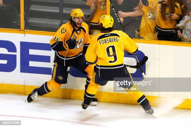 Craig Smith of the Nashville Predators celebrates with Filip Forsberg after scoring a third period goal against Matt Murray of the Pittsburgh...