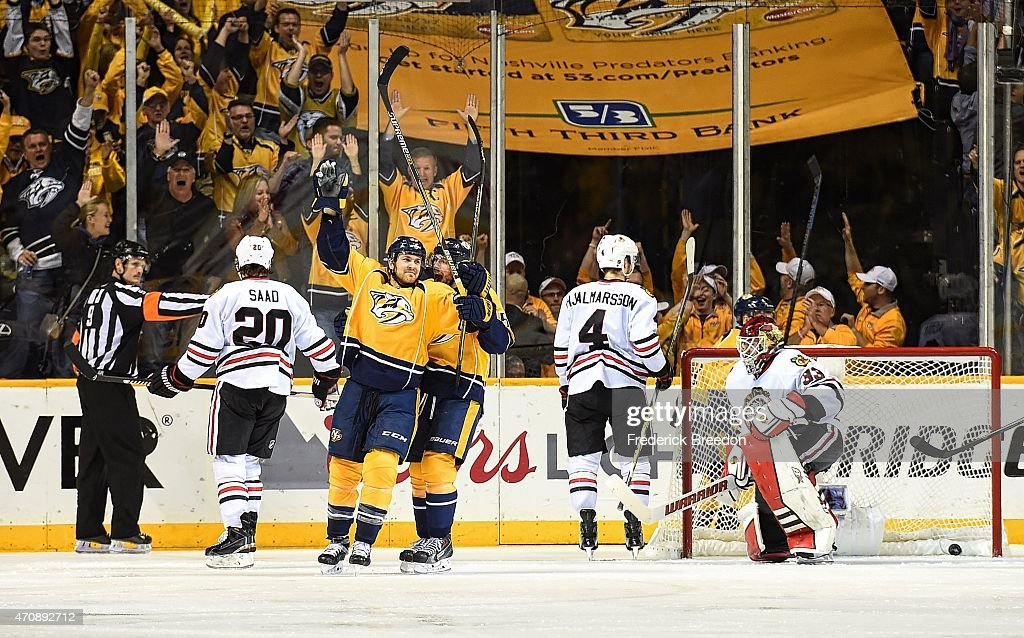 Craig Smith #15 of the Nashville Predators congratulates teammate Colin Wilson #33 on scoring a power play goal against goalie Scott Darling #33 of the Chicago Blackhawks during the third period of Game Five of the Western Conference Quarterfinals during the 2015 NHL Stanley Cup Playoffs at Bridgestone Arena on April 23, 2015 in Nashville, Tennessee.