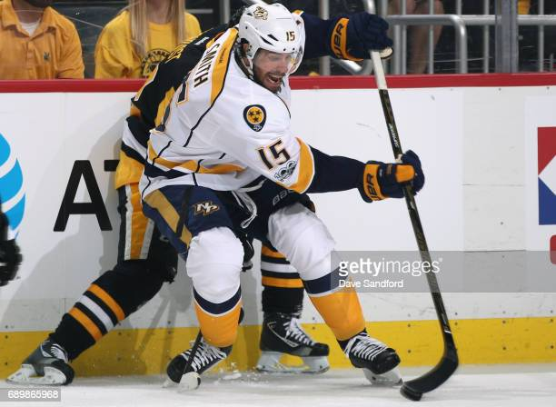 Craig Smith of the Nashville Predators controlled the puck against the Pittsburgh Penguins during the first period of Game One of the 2017 NHL...