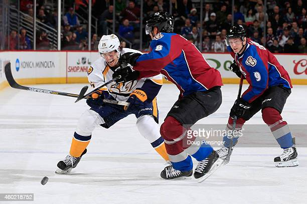 Craig Smith of the Nashville Predators controls the puck against Jan Hejda of the Colorado Avalanche at Pepsi Center on December 9 2014 in Denver...