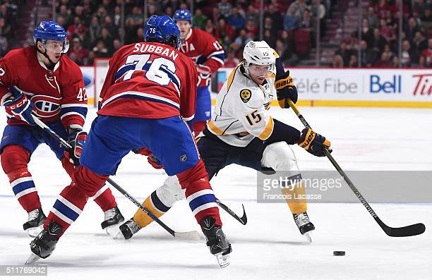 Craig Smith of the Nashville Predators controls the puck against PK Subban of the Montreal Canadiens in the NHL game at the Bell Centre on February...
