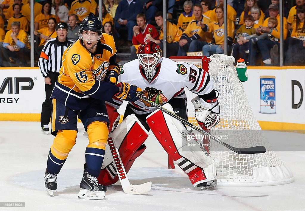 Craig Smith #15 of the Nashville Predators eyes the play along the boards against Scott Darling #33 of the Chicago Blackhawks in the second overtime Game One of the Western Conference Quarterfinals during the 2015 NHL Stanley Cup Playoffs at Bridgestone Arena on April 15, 2015 in Nashville, Tennessee.