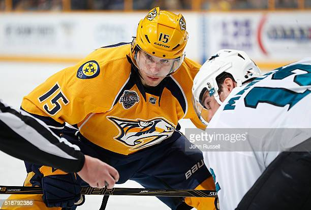 Craig Smith of the Nashville Predators faces off against Patrick Marleau of the San Jose Sharks during an NHL game at Bridgestone Arena on April 2...
