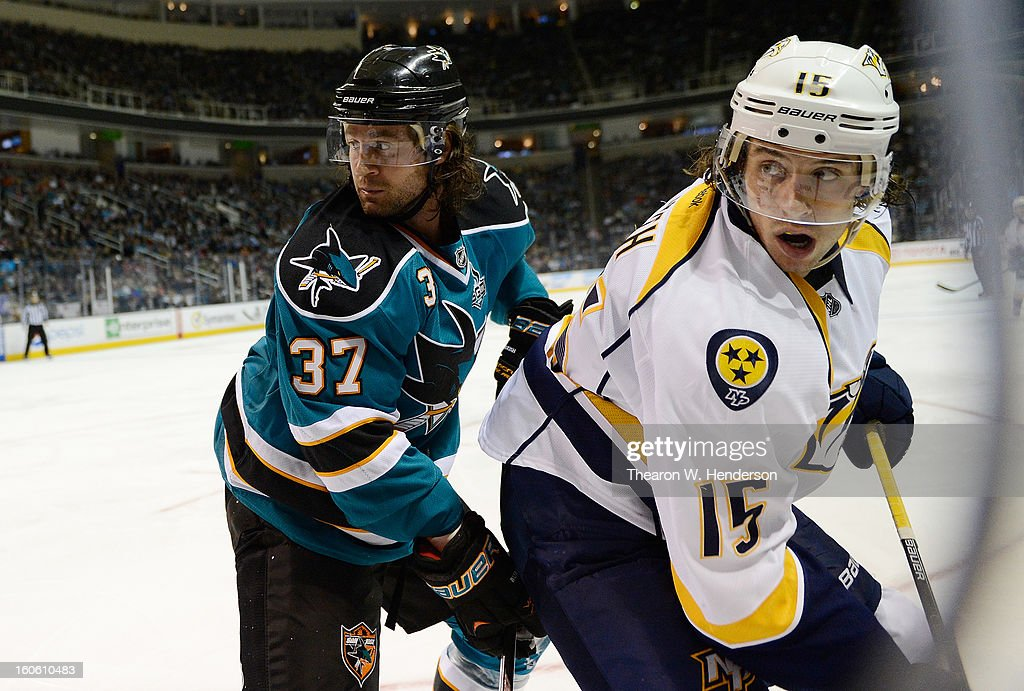 Craig Smith #15 of the Nashville Predators gets checked from behind Adam Burish #37 of the San Jose Sharks at HP Pavilion on February 2, 2013 in San Jose, California.