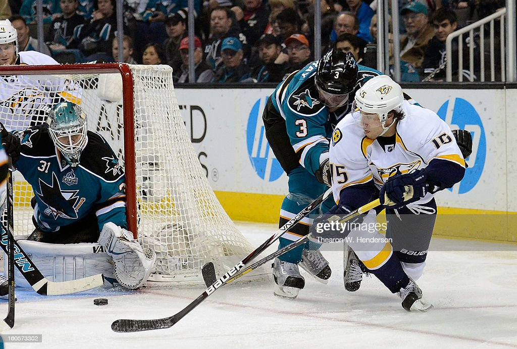 Craig Smith #15 of the Nashville Predators gets his backhand shot past Douglas Murray #3 but blocked by goalkeeper Antti Niemi #31 of the San Jose Sharks in the third period of their game at HP Pavilion on February 2, 2013 in San Jose, California. The Predators won the game in an overtime shoot-out 2-1.