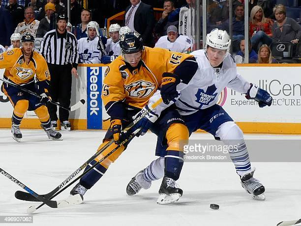 Craig Smith of the Nashville Predators gets tied up by Jake Gardiner of the Toronto Maple Leafs during the third period at Bridgestone Arena on...