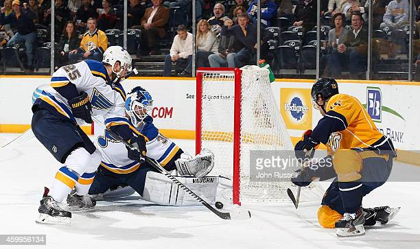 Craig Smith of the Nashville Predators has his backhand shot blocked by goalie Martin Brodeur of the St Louis Blues as Chris Butler defends at...