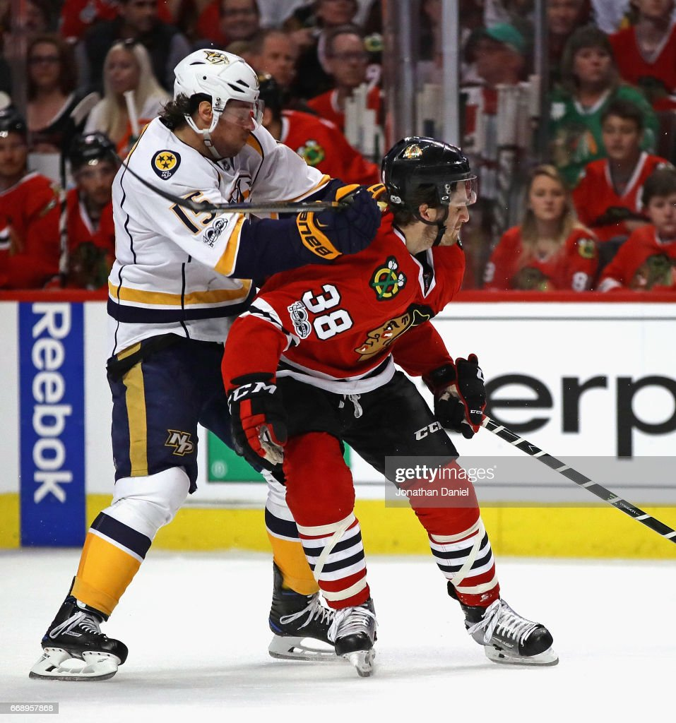 Craig Smith #15 of the Nashville Predators hits Ryan Hartman #38 of the Chicago Blackhawks across the back of the neck with his stick in Game Two of the Western Conference First Round during the 2017 NHL Stanley Cup Playoffs at the United Center on April 15, 2017 in Chicago, Illinois.