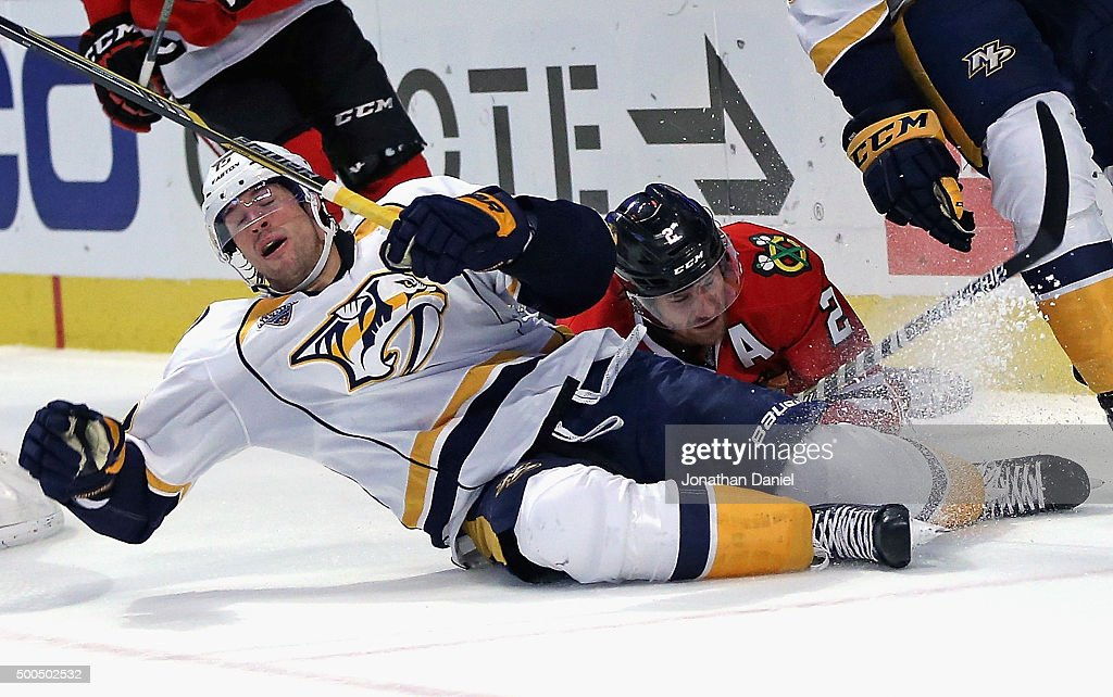 Craig Smith #15 of the Nashville Predators hits the ice after colliding with Duncan Keith #2 of the Chicago Blackhawks at United Center on December 8, 2015 in Chicago, Illinois. The Blackhawks defeated the Predators 4-1.