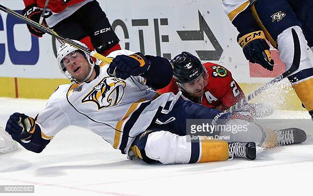 Craig Smith of the Nashville Predators hits the ice after colliding with Duncan Keith of the Chicago Blackhawks at United Center on December 8 2015...