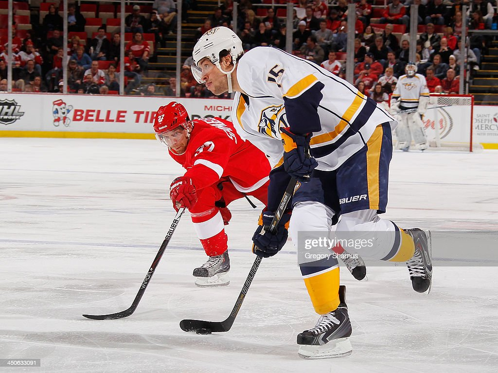 Craig Smith #15 of the Nashville Predators looks to take a second-period shot in front of Mikael Samuelsson #37 of the Detroit Red Wings at Joe Louis Arena on November 19, 2013 in Detroit, Michigan.