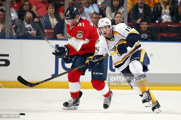 Craig Smith of the Nashville Predators passes the puck against Greg McKegg of the Florida Panthers during second period action at the BBT Center on...