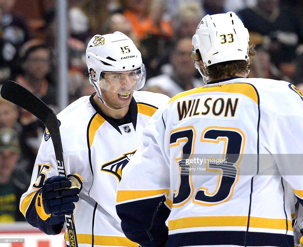 Craig Smith #15 of the Nashville Predators reacts to his goal with Colin Wilson #33 to take a 3-2 lead over the Anaheim Ducks during the third period at Honda Center on January 4, 2015 in Anaheim, California.
