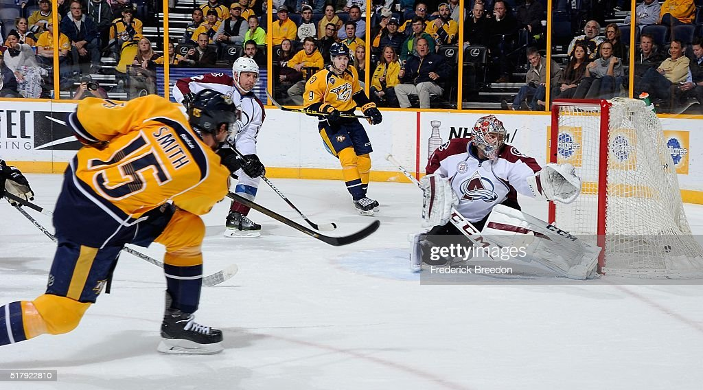 Craig Smith #15 of the Nashville Predators scores a goal against goalie Semyon Varlamov #1 of the Colorado Avalanche during the first period at Bridgestone Arena on March 28, 2016 in Nashville, Tennessee.