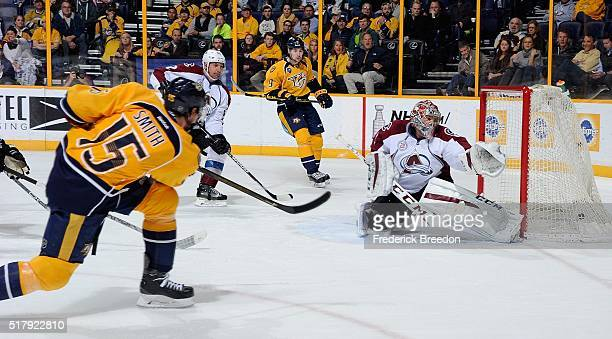 Craig Smith of the Nashville Predators scores a goal against goalie Semyon Varlamov of the Colorado Avalanche during the first period at Bridgestone...