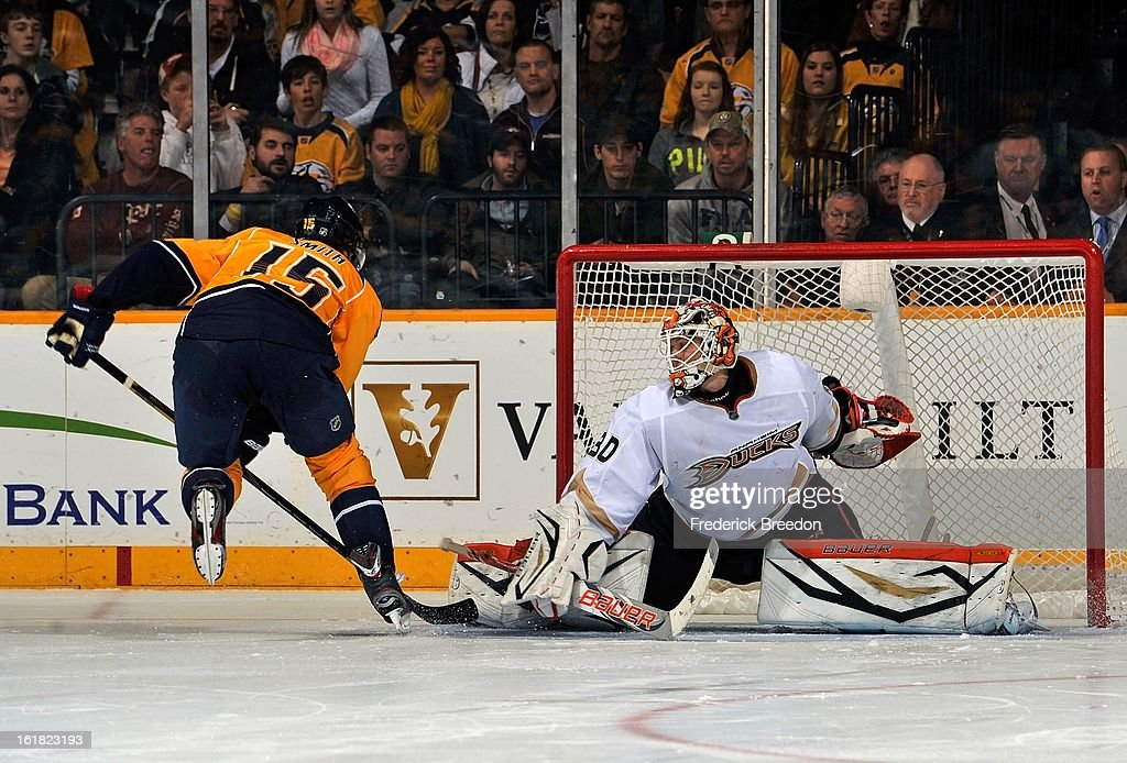 Craig Smith #15 of the Nashville Predators scores a shootout goal against goalie Viktor Fasth #30 of the Anaheim Ducks at the Bridgestone Arena on February 16, 2013 in Nashville, Tennessee.
