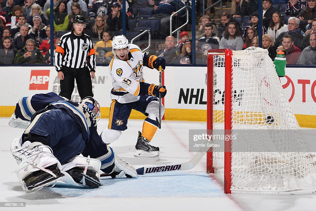 Craig Smith #15 of the Nashville Predators scores on goaltender Sergei Bobrovsky #72 of the Columbus Blue Jackets during the second period on December 22, 2014 at Nationwide Arena in Columbus, Ohio.