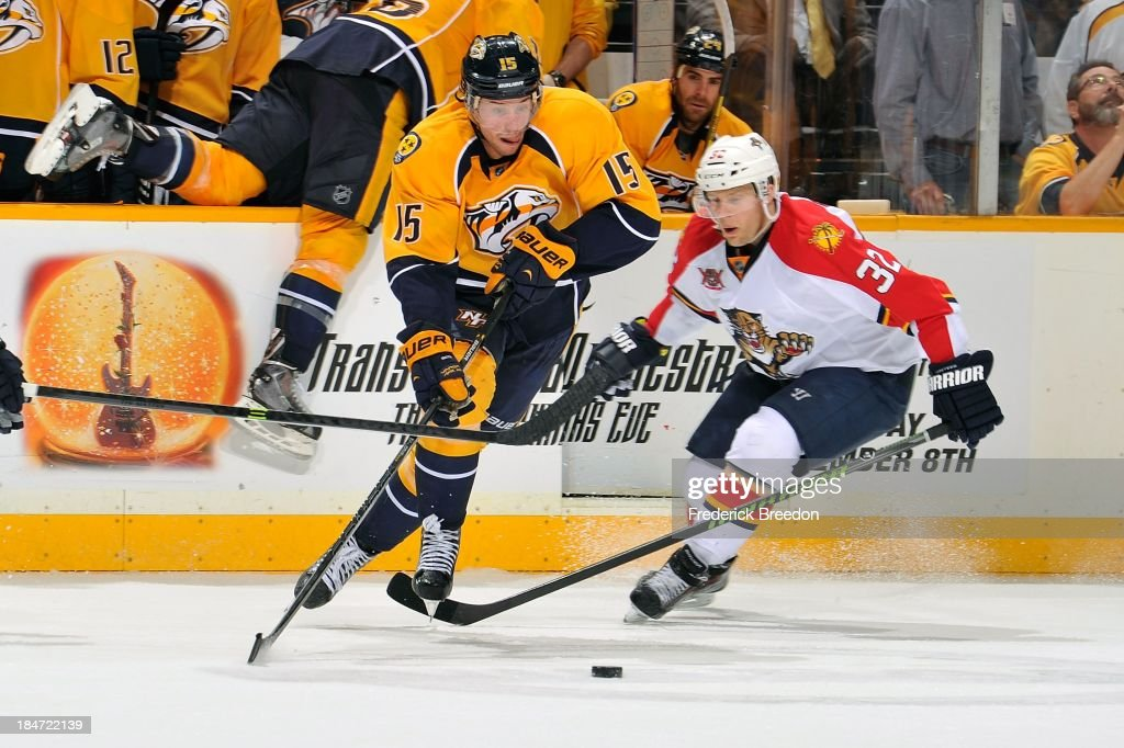 Craig Smith #15 of the Nashville Predators skates against <a gi-track='captionPersonalityLinkClicked' href=/galleries/search?phrase=Kris+Versteeg&family=editorial&specificpeople=2242969 ng-click='$event.stopPropagation()'>Kris Versteeg</a> #32 of the Florida Panthers at Bridgestone Arena on October 15, 2013 in Nashville, Tennessee.