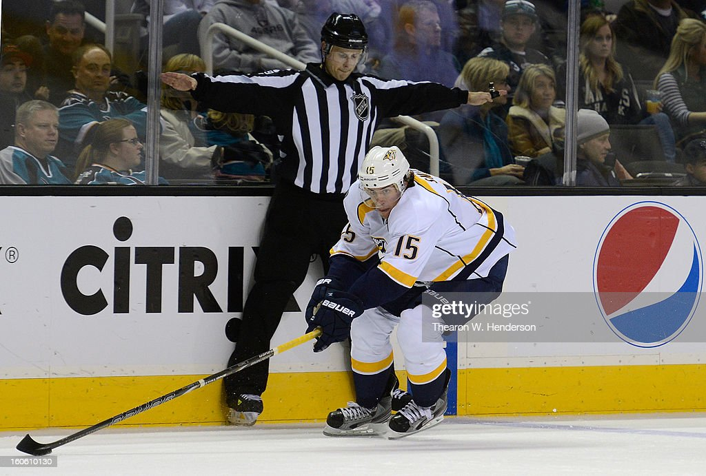 Craig Smith #15 of the Nashville Predators skates to gain control of the puck against the San Jose Sharks in the second period at HP Pavilion on February 2, 2013 in San Jose, California.