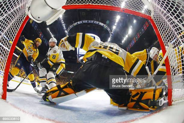 Craig Smith of the Nashville Predators skates to the goal as Brian Dumoulin Ian Cole and Matt Murray of the Pittsburgh Penguins defend during the...