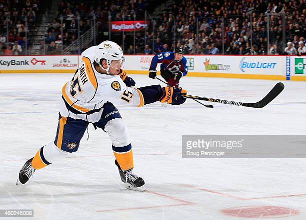 Craig Smith of the Nashville Predators takes a shot against the Colorado Avalanche at Pepsi Center on December 9 2014 in Denver Colorado The...