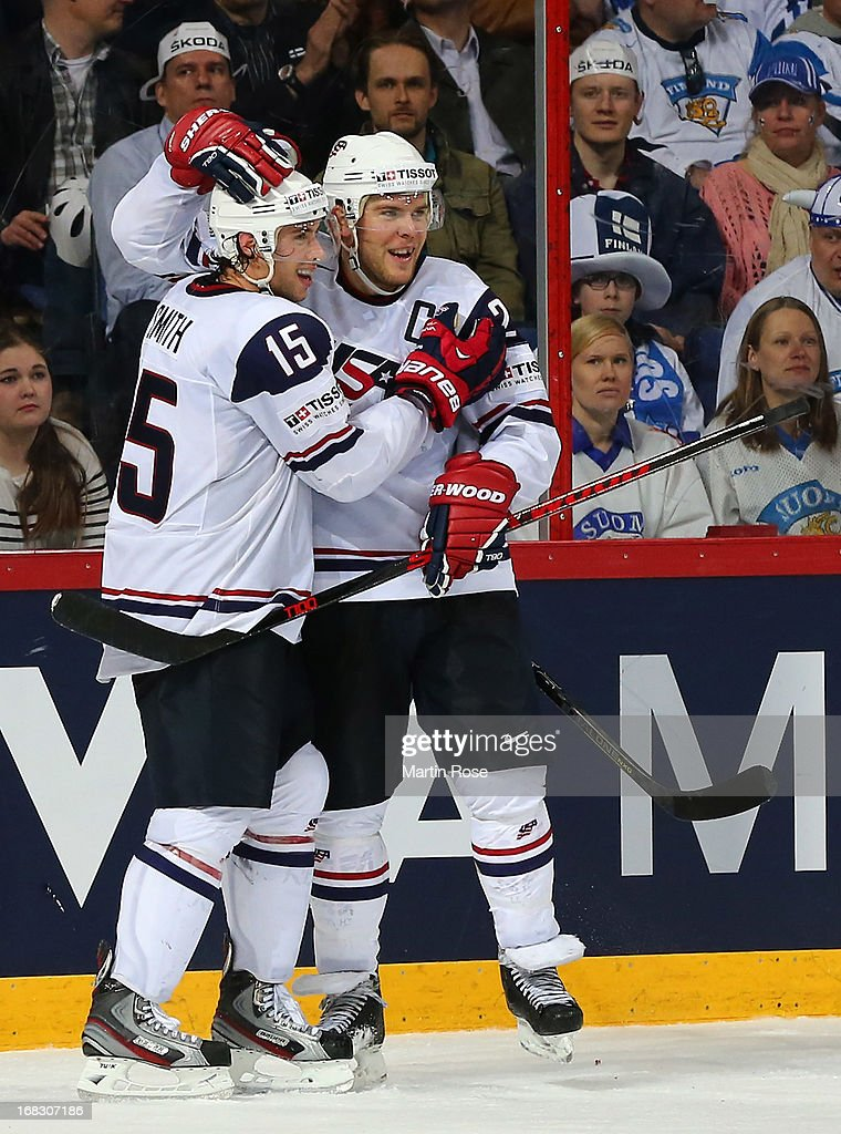 Craig Smith (L) of USA celebrate with team mate <a gi-track='captionPersonalityLinkClicked' href=/galleries/search?phrase=Paul+Stastny&family=editorial&specificpeople=2494330 ng-click='$event.stopPropagation()'>Paul Stastny</a> after he scores his team's 4th goal during the IIHF World Championship group H match between USA and Finland at Hartwall Areena on May 8, 2013 in Helsinki, Finland.