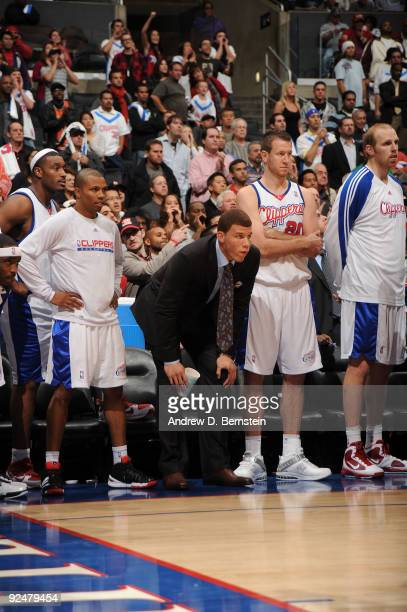 Craig Smith Sebastian Telfair Blake Griffin Steve Novak and Chris Kaman of the Los Angeles Clippers watch from the bench during their game against...