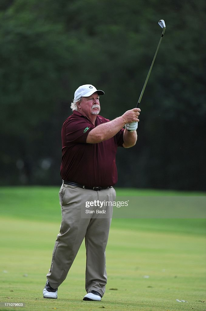 <a gi-track='captionPersonalityLinkClicked' href=/galleries/search?phrase=Craig+Stadler&family=editorial&specificpeople=211286 ng-click='$event.stopPropagation()'>Craig Stadler</a> hits a shot on the 13th hole during the first round of the Encompass Championship at North Shore Country Club on June 21, 2013 in Glenview, Illinois.