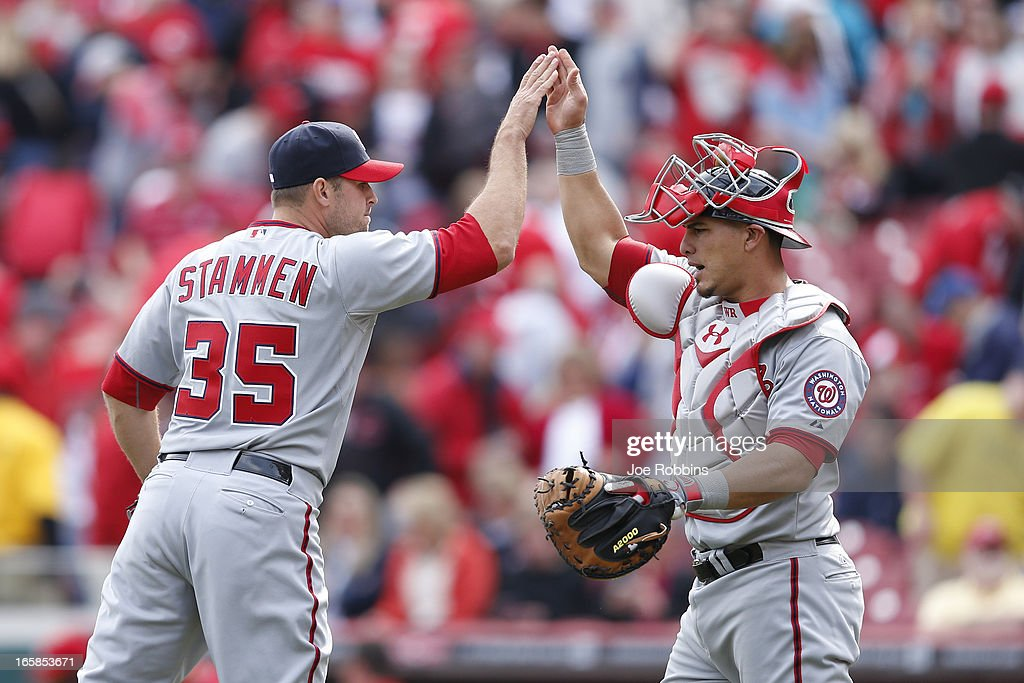 Craig Stammen #35 and Wilson Ramos #40 of the Washington Nationals celebrate after the game against the Cincinnati Reds at Great American Ball Park on April 6, 2013 in Cincinnati, Ohio. The Nationals won 7-6 in 11 innings.