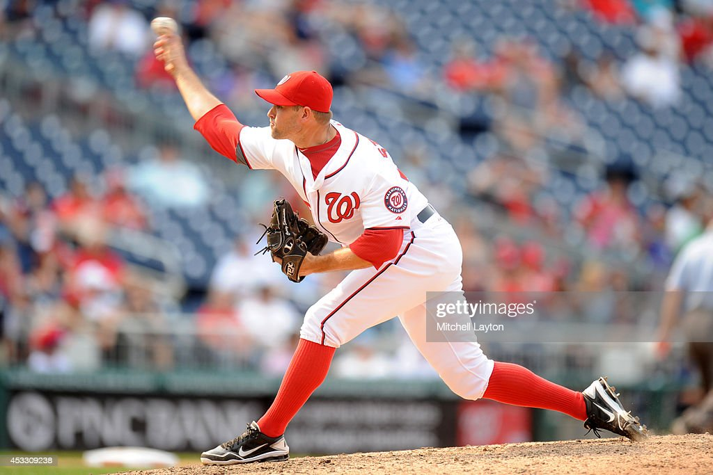 <a gi-track='captionPersonalityLinkClicked' href=/galleries/search?phrase=Craig+Stammen&family=editorial&specificpeople=5897564 ng-click='$event.stopPropagation()'>Craig Stammen</a> #35 of the Washington Nationals pitches the last three iniing to get the win during a baseball game against the New York Mets on August 7, 2014 at Nationals Park in Washington, DC. The Nationals won 5-3 in the 13th inning.