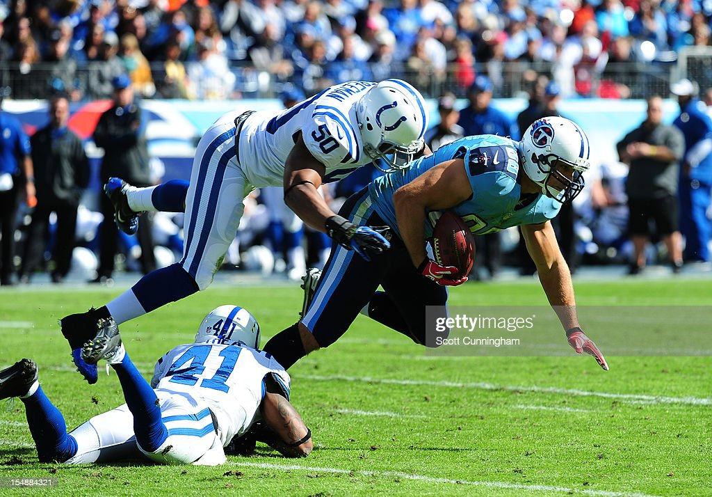 Craig Stevens #88 of the Tennessee Titans is tackled by Jerrell Freeman #50 and <a gi-track='captionPersonalityLinkClicked' href=/galleries/search?phrase=Antoine+Bethea&family=editorial&specificpeople=2535027 ng-click='$event.stopPropagation()'>Antoine Bethea</a> #41 of the Indianapolis Colts at LP Field on October 28, 2012 in Nashville, Tennessee.
