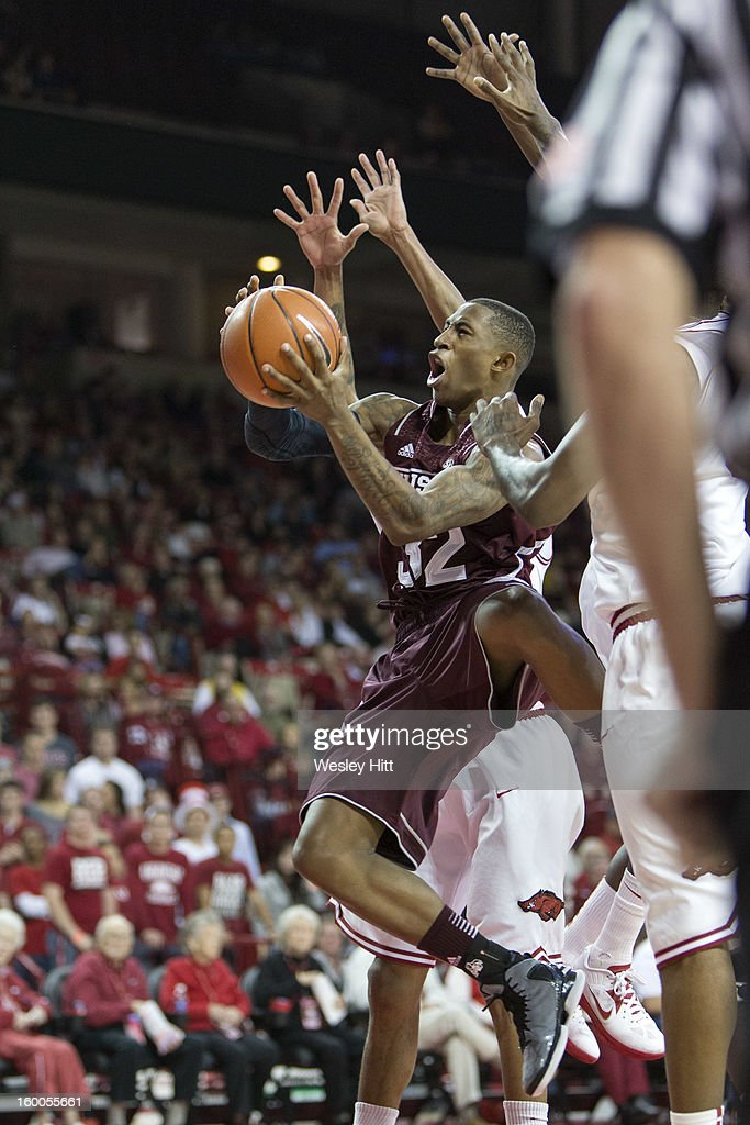 Craig Sword #32 of the Mississippi State Bulldogs goes up for a layup against the Arkansas Razorbacks at Bud Walton Arena on January 23, 2013 in Fayetteville, Arkansas. The Razorbacks defeated the Bulldogs 96-70.