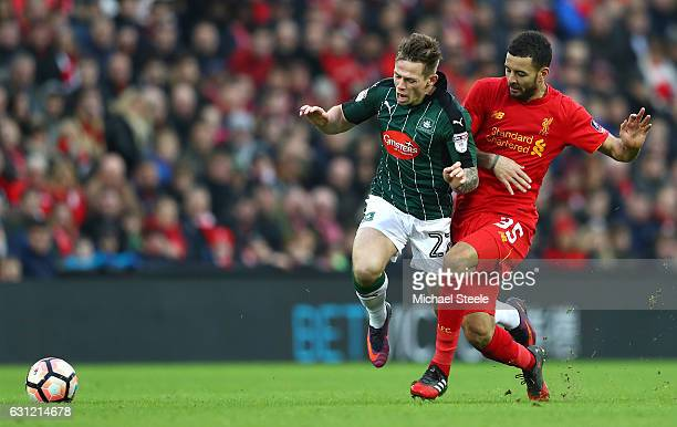 Craig Tanner of Plymouth Argyle is fouled by Kevin Stewart of Liverpool during The Emirates FA Cup Third Round match between Liverpool and Plymouth...