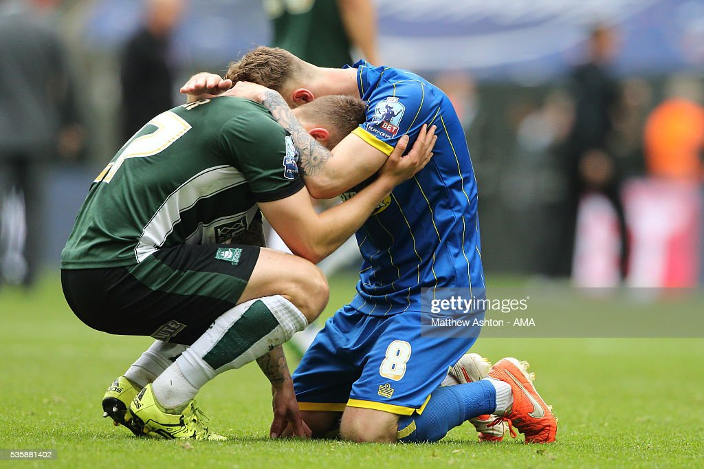 Craig Tanner of Plymouth Argyle, who was on loan to AFC Wimbledon earlier in the season, is consoled by Jake Reeves of AFC Wimbledon after losing in the Sky Bet League Two Play Off Final between Plymouth Argyle and AFC Wimbledon at Wembley Stadium on May 30, 2016 in London, England.