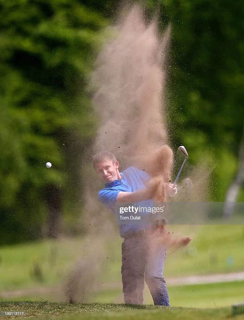 Craig Tudor of Mold plays out the bunker on the 6th hole during the Virgin Atlantic PGA National Pro-Am Championship Regional Qualifier at Dunham Forest Golf and Country Club on May 21, 2010 in Manchester, England.