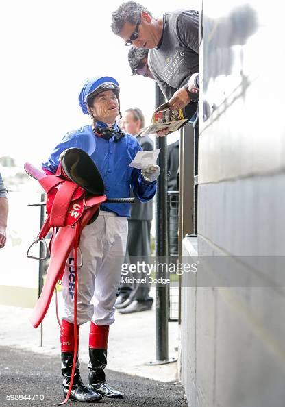 Craig Williams chats with a punter after riding Furnaces in race Mitty's Racing Colours McEwen Stakes at Moonee Valley Racecourse on September 03...