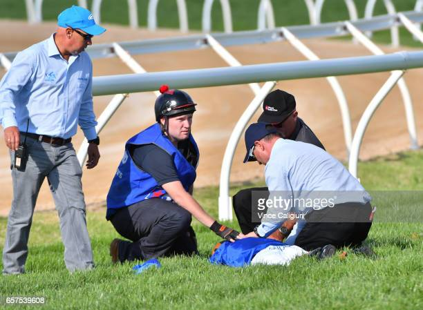Craig Williams is being helped by attendants after falling off The Gold Trail for the Godolphin stable after the winner post in Race 7 Ladbrokes...