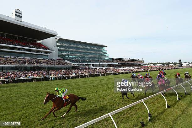Craig Williams rides Scarlet Billows to win race ten The Hong Kong Jockey Club Stakes on Melbourne Cup Day at Flemington Racecourse on November 3...