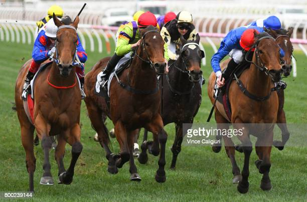 Craig Williams riding Ability defeats Ben Allen riding Husson Eagle in Race 6 during Melbourne Racing at Flemington Racecourse on June 24 2017 in...