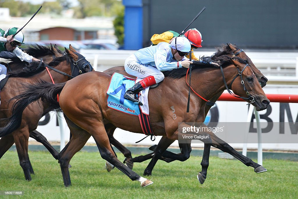 Craig Williams riding Avoid Lightning races to win the Monjon Security W.J Adams Stakes during National Jockey's Trust Race Day at Caulfield Racecourse on February 2, 2013 in Melbourne, Australia.
