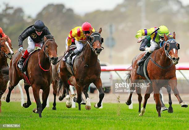 Craig Williams riding Bengal Cat wins race 1 the Murray Cox Handicap ahead of El Greco ridden by Luke Nolen during the David Bourke Provincial Plate...