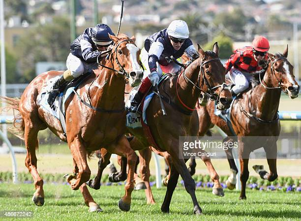 Craig Williams riding Chance to Dance defeats Damian Lane riding The United States in Race 4 during Melbourne Racing at Moonee Valley Racecourse on...