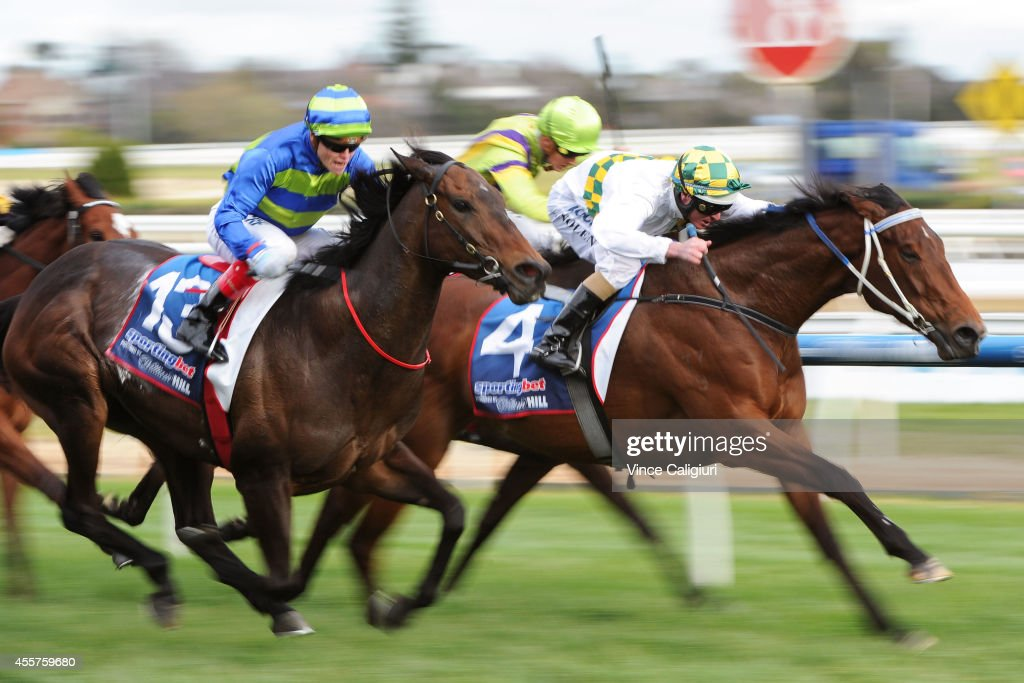 Craig Williams riding Girl Guide defeats Luke Nolen riding A Time for Julia in Race 8 during the Underwood Stakes Day at Caulfield Racecourse on...