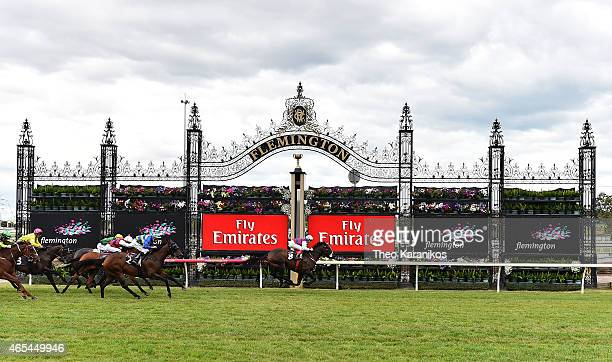 Craig Williams riding Madam Gangster wins the Frances Tressady Stakes during Australian Guineas Day at Flemington Racecourse on March 7 2015 in...