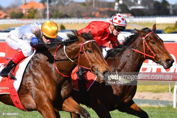 Craig Williams riding Moonlites Choice defeats Brandon Stockdale riding Hot Dipped in Race 3 during Melbourne Racing at Caulfield Racecourse on July...