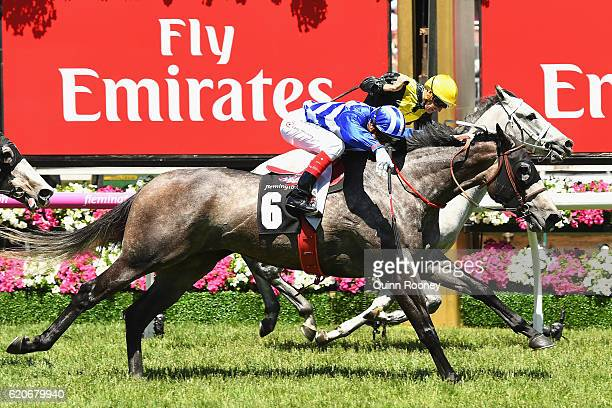 Craig Williams riding Pepperano leads Hugh Bowman riding Onerous across the line to win race 3 the Off The Track Subzero Handicap on Oaks Day at...